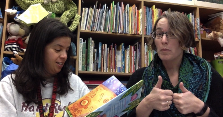 Ms. Ceci and Ms. Snyder reading a picture book