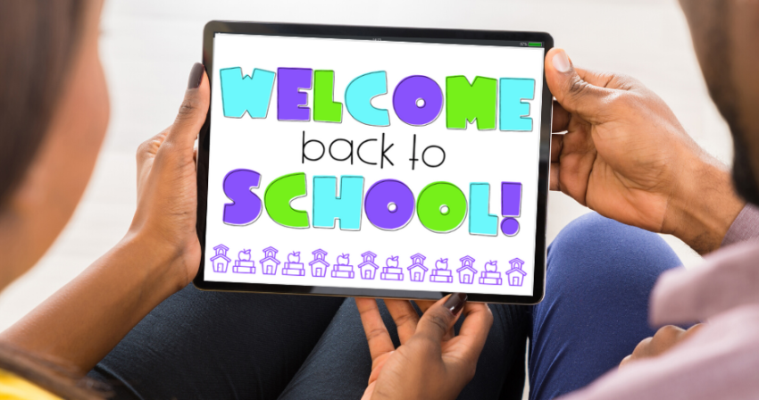 "Two sets of hands hold a tablet displaying the message ""welcome back to school"""