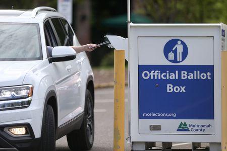 car dropping ballot into Multnomah County Ballot Box