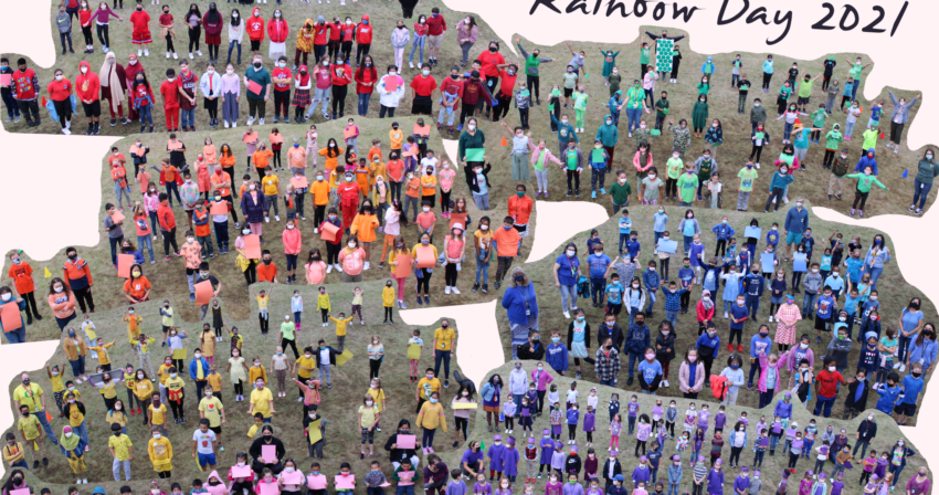 Lincoln Park students standing outside with smiling eyes and face masks. 5th grade is wearing red, 4th is in orange, 3rd has donned yellow, 2nd grade looks great in green, 1st grade wears blue, Kindergarten is proud in purple and our preschool students are pink.